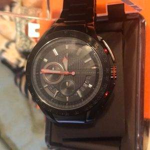 Black and red Armani exchange watch